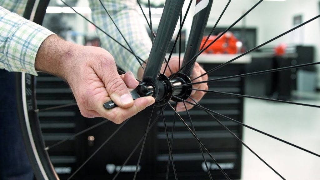how to patch a bike tube: Remove the wheel