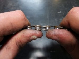 insert the pin - how to fix bicycle chain